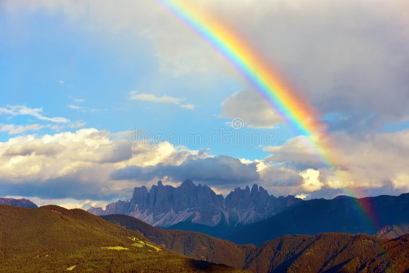 Landscape with rainbow of the Dolomites mountains. Spectacular view of the Odle val di funes south tyrol italy royalty free stock photos