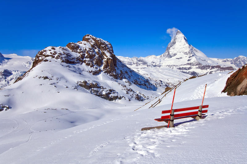 Landscape of Red chair and Matterhorn peak. Landscape of Red chair and Matterhorn, logo of Toblerone chocolate, located in Switzerland royalty free stock photos