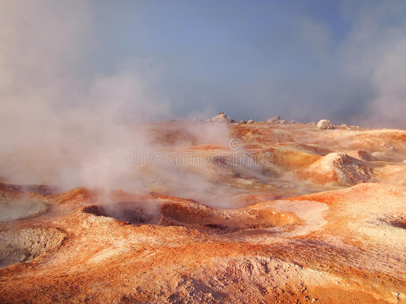 Landscape on the red planet Mars. Boiling red mud pools in the geothermal area Sol de Manana in western Bolivia near Uyuni at an elevation of 15,900 feet royalty free stock photo