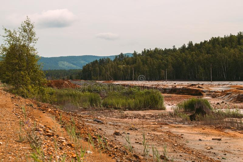 Landscape with red soil polluted copper mining factory in Karabash, Russia, Chelyabinsk region. The dirtiest city on Earth stock images