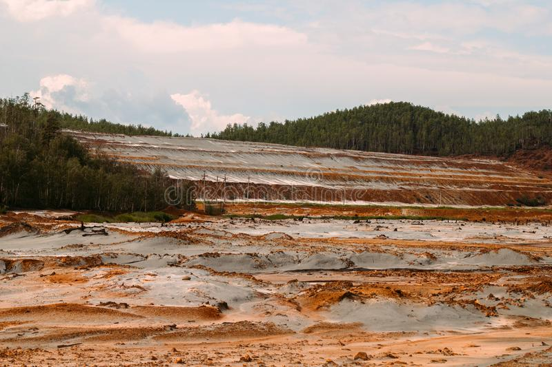 Landscape with red soil polluted copper mining factory in Karabash, Russia, Chelyabinsk region. The dirtiest city on Earth royalty free stock photos