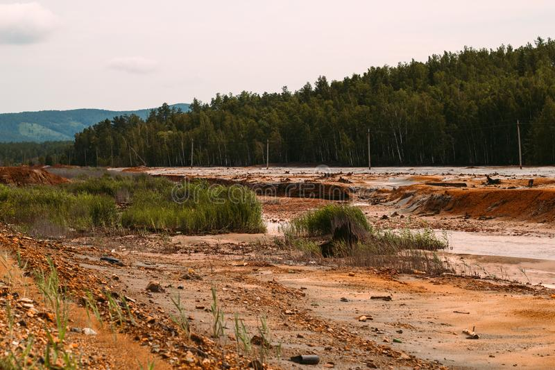 Landscape with red soil polluted copper mining factory in Karabash, Russia, Chelyabinsk region. The dirtiest city on Earth royalty free stock photo