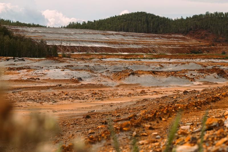 Landscape with red soil polluted copper mining factory in Karabash, Russia, Chelyabinsk region. The dirtiest city on Earth stock photography