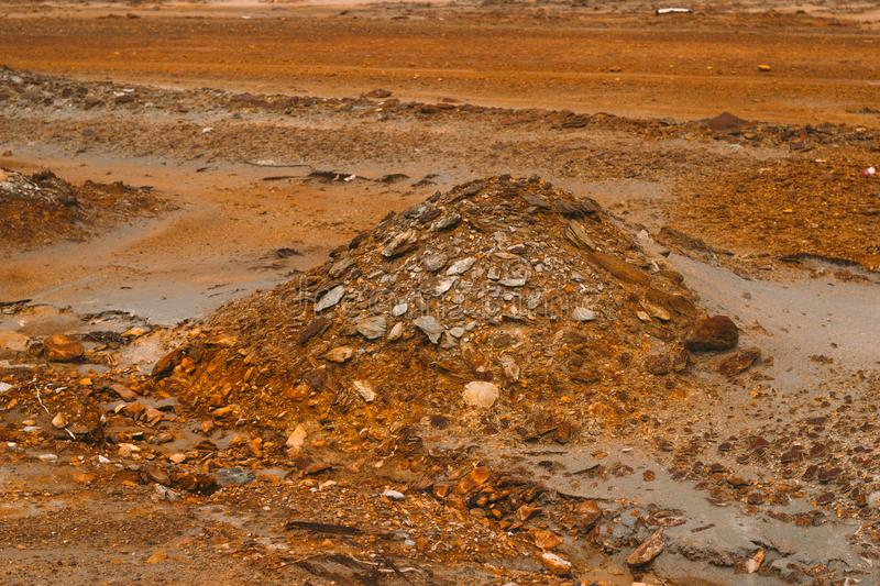 Landscape with red soil polluted copper mining factory in Karabash, Russia, Chelyabinsk region. The dirtiest city on Earth stock photo