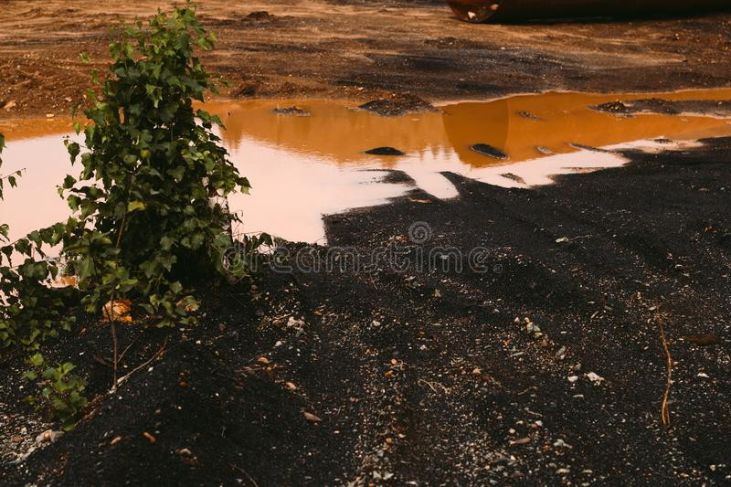 Landscape with red soil polluted copper mining factory in Karabash, Russia, Chelyabinsk region. The dirtiest city on Earth royalty free stock images