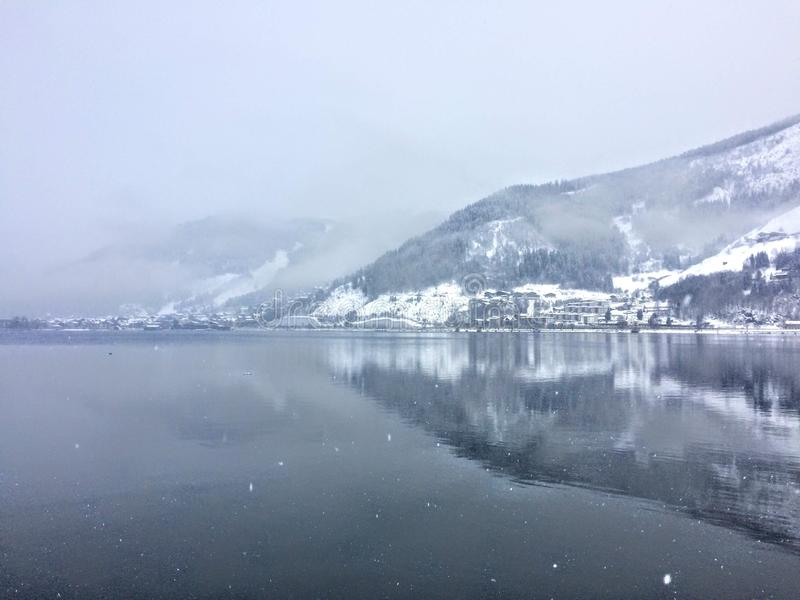 Landscape reflection on lake Zell am See, Austria in winter stock photos