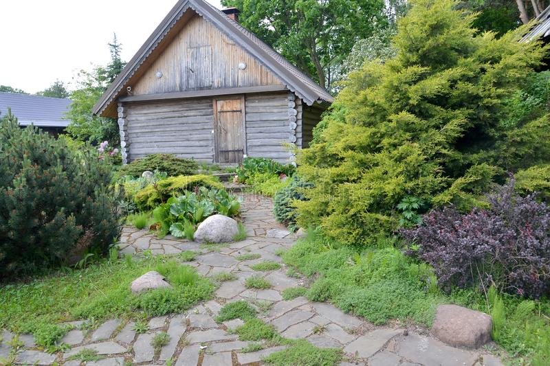 Landscape registration of the seasonal dacha with a bath.  stock image