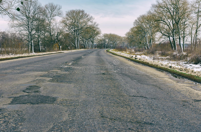 Landscape with remote empty road at late autumn in central Ukraine. Old photo stylized landscape with remote empty road at late autumn in central Ukraine royalty free stock photo