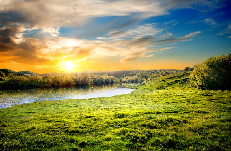 Landscape with the rive. Spring landscape with the river and the sun stock image