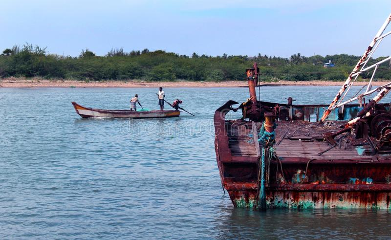A landscape of the river arasalaru with old and new boats near karaikal beach. A landscape of the river arasalaru with old and new boats near karaikal beach royalty free stock images