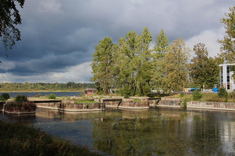 Landscape on the river bank with clouds in inclement weather. Landscape on the bank of a river with clouds in inclement weather on the eve of a storm stock photos