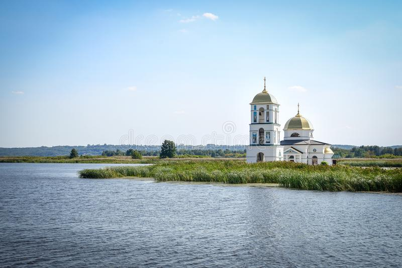 Landscape. The river Dnieper. And the church on the beach royalty free stock photo