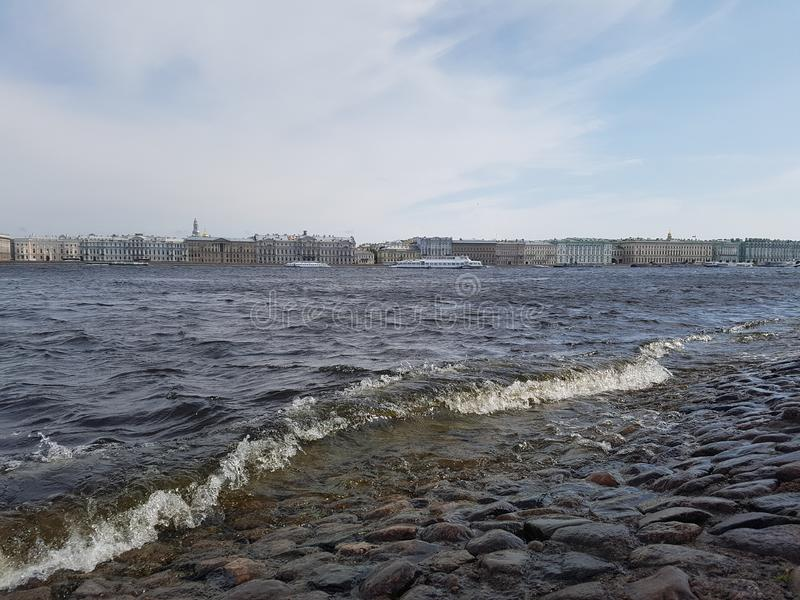 Landscape of the river, ships and buildings of the city. On the other side. City of St. Petersburg, the Neva River, June 2019 royalty free stock photo
