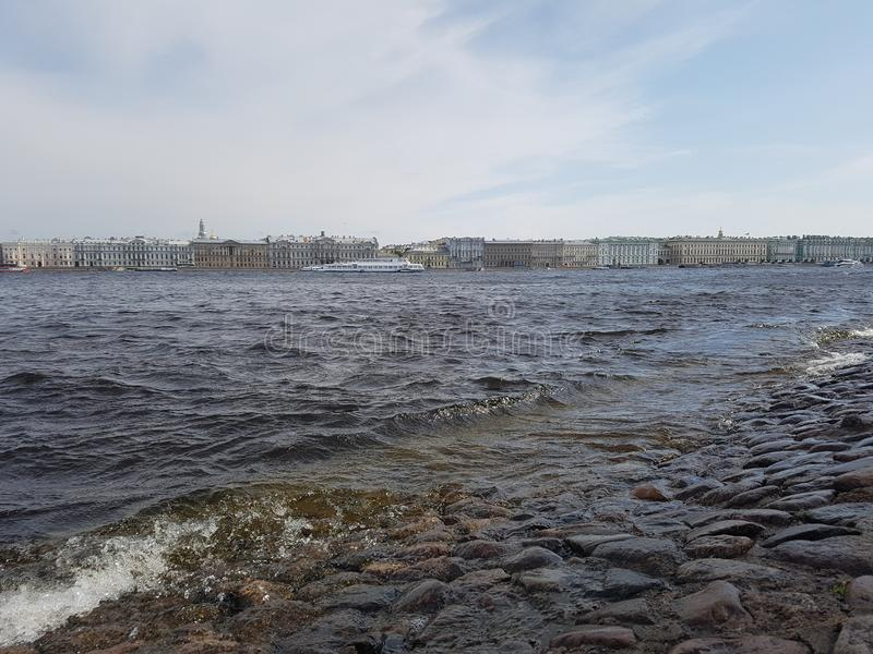 Landscape of the river, ships and buildings of the city. On the other side. City of St. Petersburg, the Neva River, June 2019 stock photography