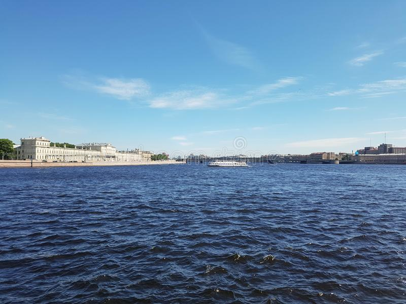 Landscape of the river. Ships and buildings of the city on the other side. City of St. Petersburg, the Neva River, June 2019 stock image