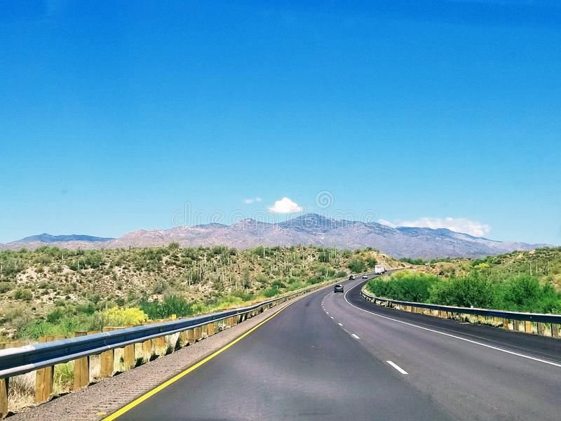 Landscape with road in Arizona USA. Taking a road trip while traveling in Arizona USA. One of the most beautiful roads royalty free stock photography