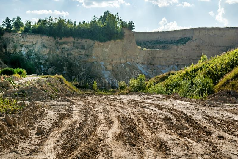 Landscape with a road. To the clay quarry royalty free stock image