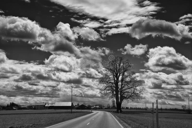 Landscape of the road to town of Fussen near Kirchberg an der Iller in black and white. Landscape of the road to town of Fussen near Kirchberg an der Iller in royalty free stock photography