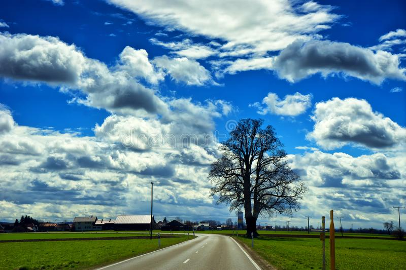 Landscape of the road to town of Fussen near Kirchberg an der Iller. In Schwarzwald in the state of Baden-Württemberg in southwest Germany stock image