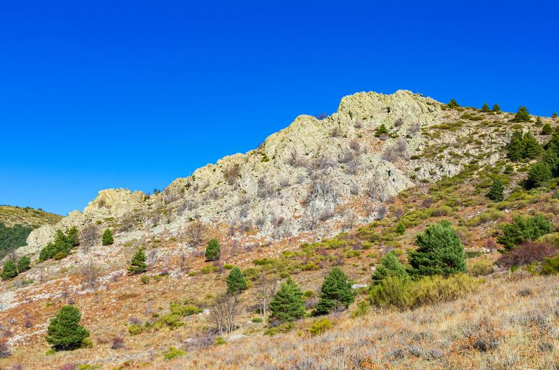 Landscape of a rocky mountain and deep blue sky royalty free stock photos
