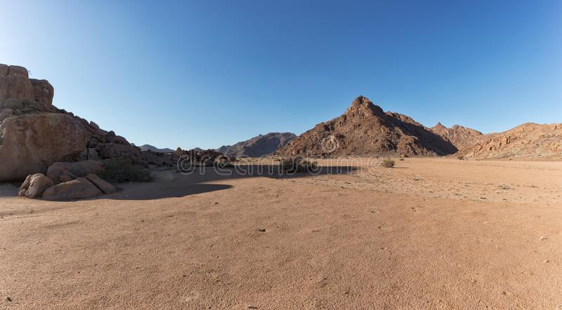 Landscape with rocky mountains in the Namibian desert. Sesriem, Sossusvlei. royalty free stock photos