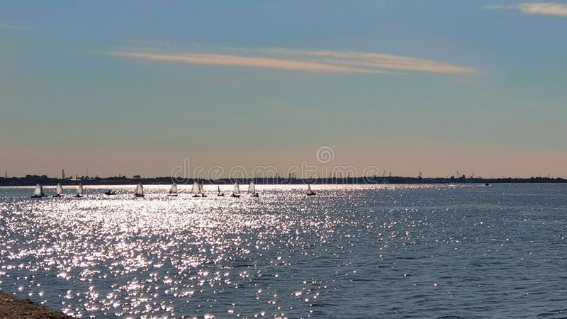 Landscape romantic summer blue sky and seascape yachting on the ocean scene boat on the sea shell on the rock sea landscape view o. Romantic summer blue sky ans royalty free stock images