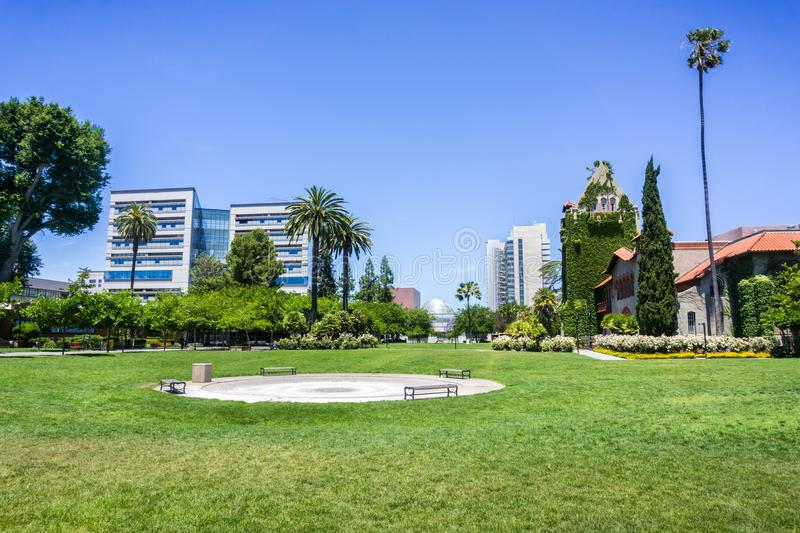Landscape in the San Jose State University campus; San Jose, California. Landscape in the San Jose State University campus; modern buildings in the background royalty free stock photo