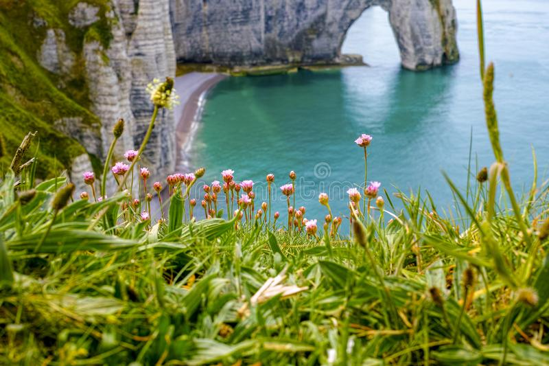 Scenic alabaster chalk cliffs of Etretat and coast of Atlantic ocean, travel and vacation destination in Normandy, France stock photos