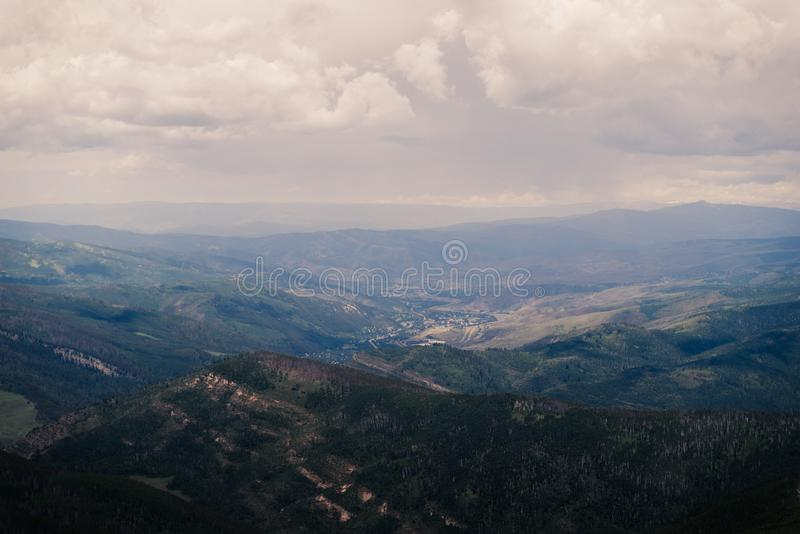 Landscape view of Minturn, Colorado with storm clouds overhead. Landscape, scenic view of Minturn, Colorado in the summer with storm clouds rolling in stock images