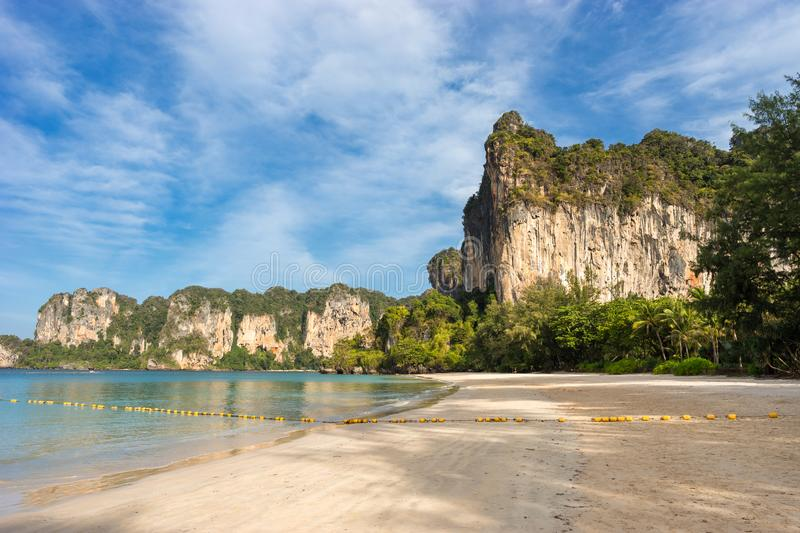 Landscape scenic view on West Railay with big cliff on the shore and empty sandy beach in the morning stock photos