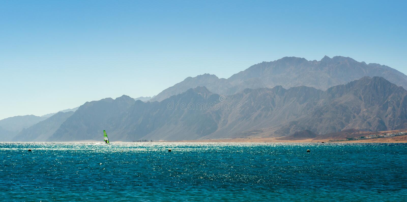 Landscape sea and high rocky mountains on the coast in Egypt. Landscape sea and high rocky mountains on the coast stock photo