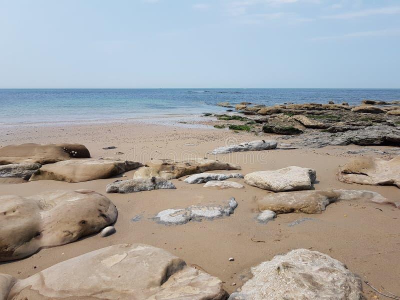 Landscape sea rock blue sand beach stock photography