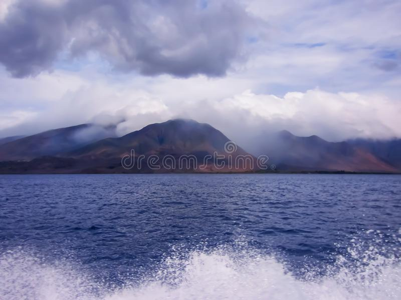 Lines Created by Clouds, Mountains, Ocean and Spray stock photo