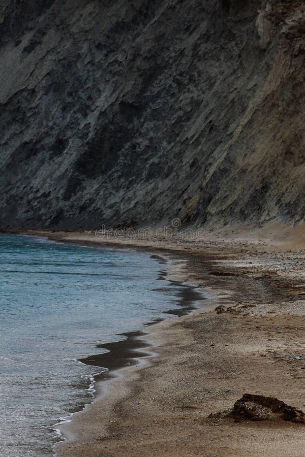 Landscape of seaside shore, Kara-Dag mountains in south winter day. Black Sea, Koktebel, Crimea royalty free stock images