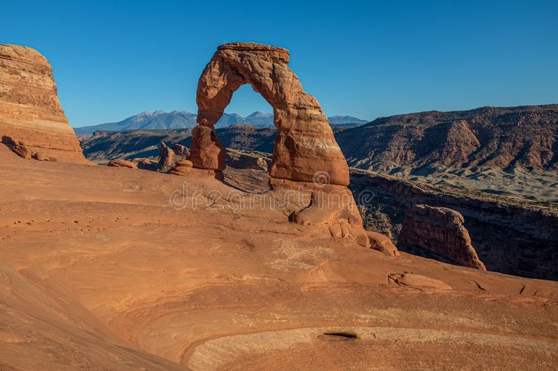 A landscape shot of the beautiful Delicate Arch at dusk at Arches National Park stock image