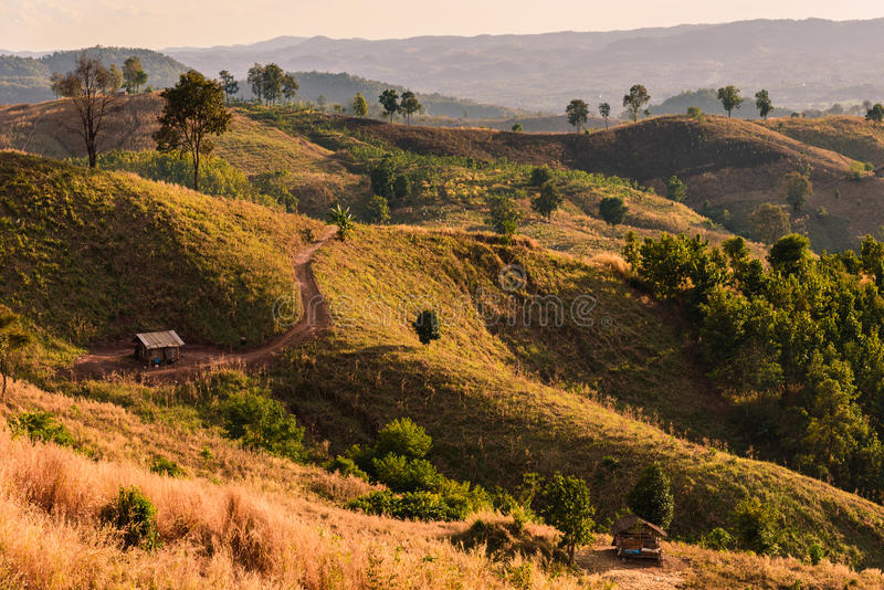 A landscape shot of rolling hills and dry brush on a trail. In Thailand royalty free stock images