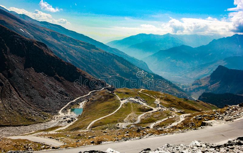 Landscape showing blue sky mountains and roads across the himalaya mountain for travel holiday at kashmir ladakh india royalty free stock image