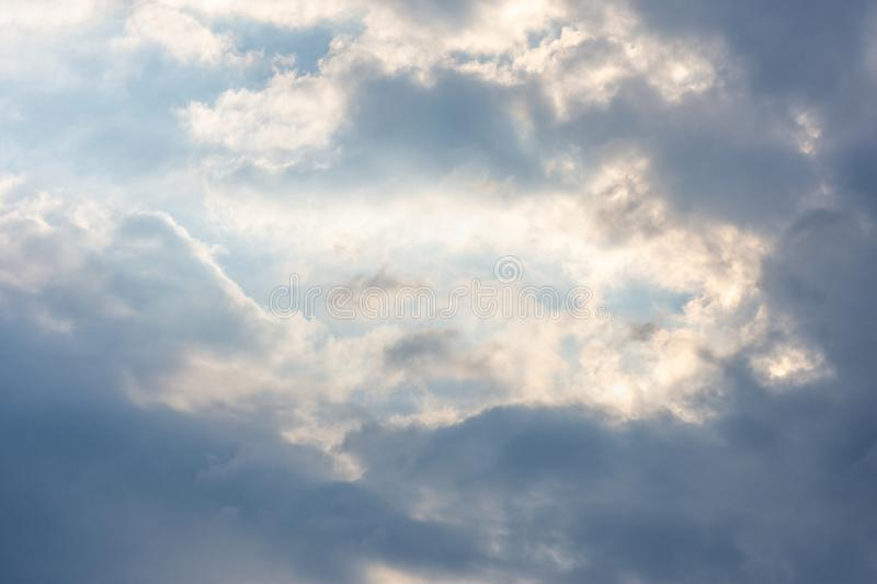 Landscape sky with blue clouds and sunbeams at sunset. Background texture stock photos