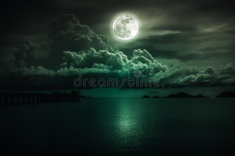 Landscape of sky with full moon on seascape to night. Serenity n. Beautiful landscape view of the sea. Colorful emerald sky with clouds and bright full moon on royalty free stock photo
