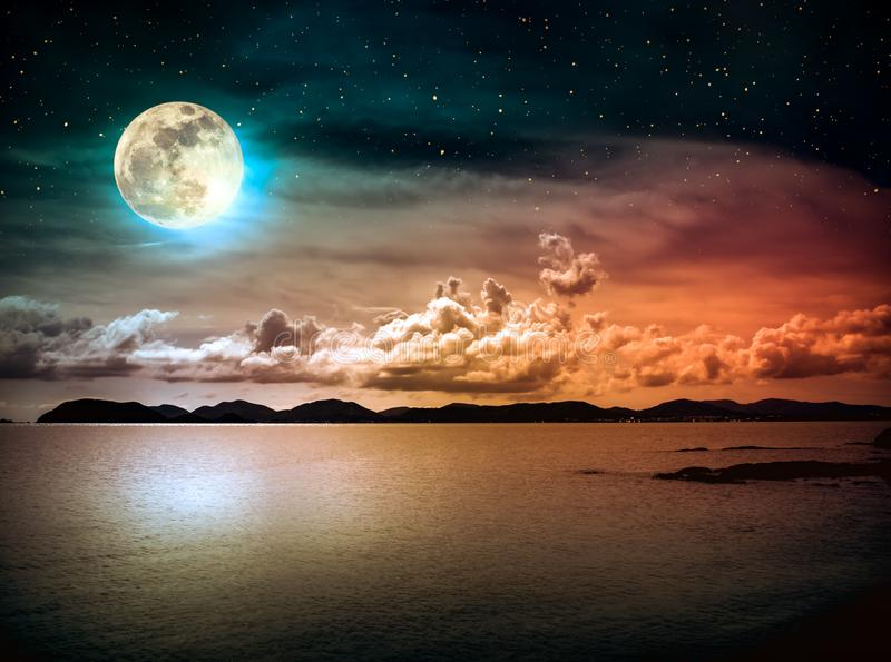 Landscape of sky with full moon on seascape to night. Serenity n. Beautiful landscape view of the sea with many stars . Attractive dark sky with cloud and full royalty free stock image