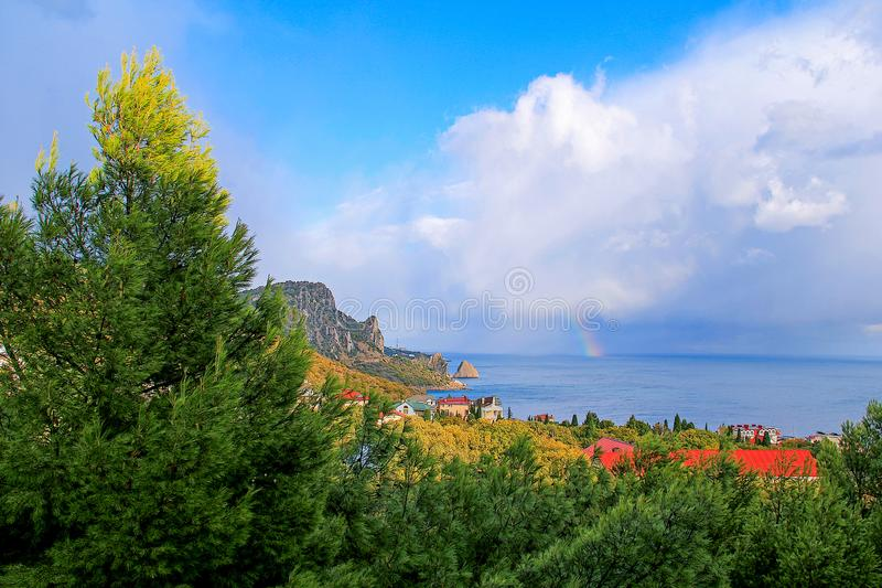 clouds sea and mountain Cat stock images