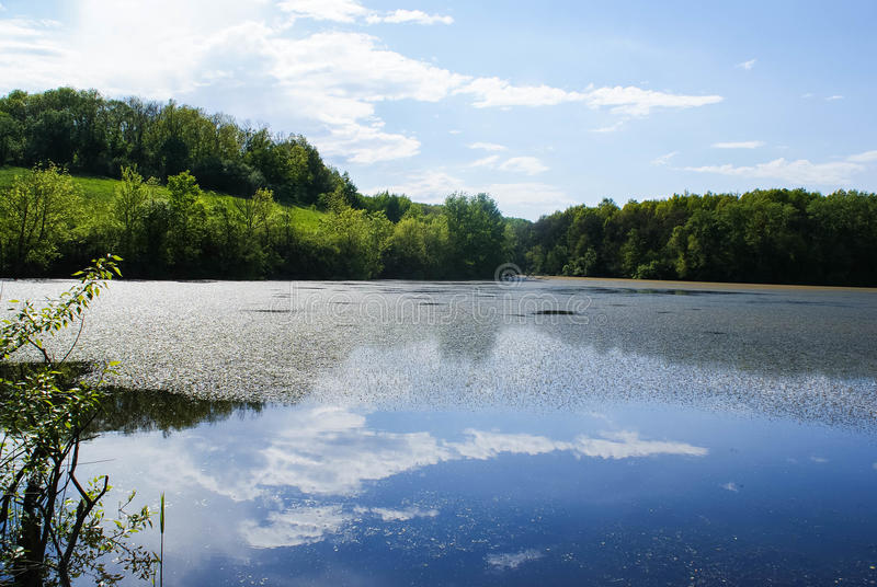 landscape with sky reflected in water stock images