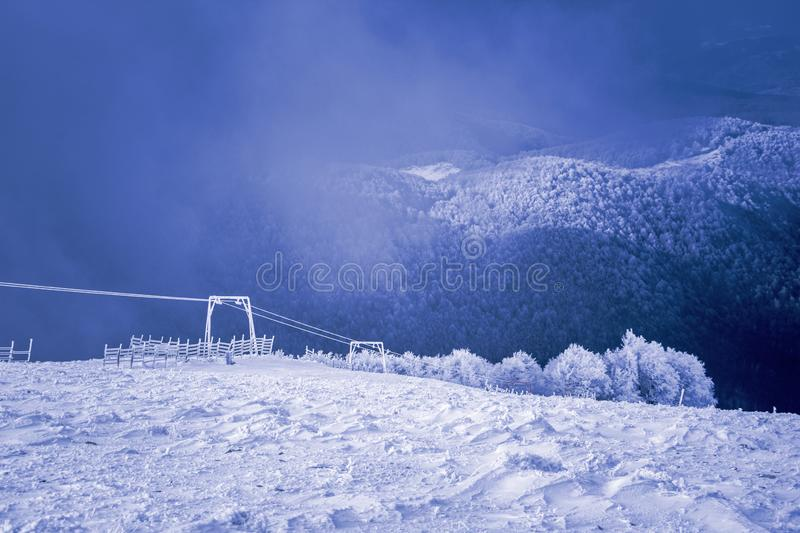 Landscape of snow mountains, lift and fence in 3-5 Pigadia, Naoussa, Greece.  stock photo
