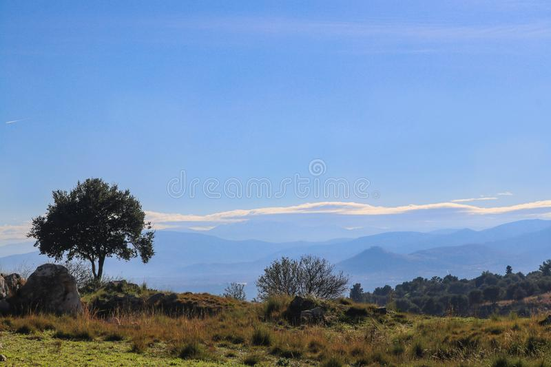 Landscape with snowcovered mountains in the distance near Mycenae Greece on the Peloponnese Peninsula. A Landscape with snowcovered mountains in the distance stock image