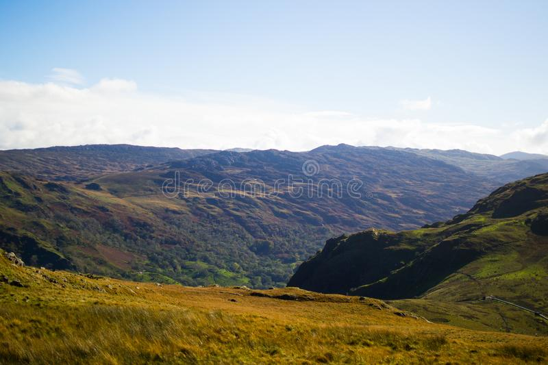 Landscape in Snowdonia National Park. Mountains and meadows in a sunny day.  royalty free stock photography