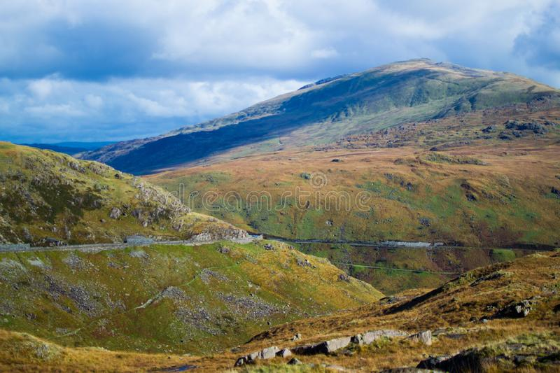 Landscape in Snowdonia National Park in Wales, with a road through the mountains.  royalty free stock image