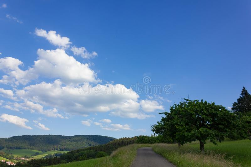 landscape springtime green fields with blue sky and clouds royalty free stock images