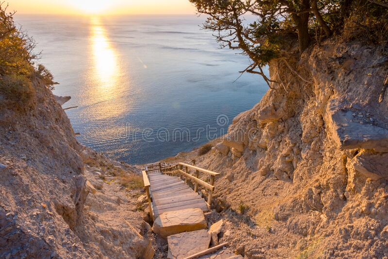 Landscape, a staircase from the mountain descends to the sea. Landscape, a staircase from the mountain descends to the  sea royalty free stock photos