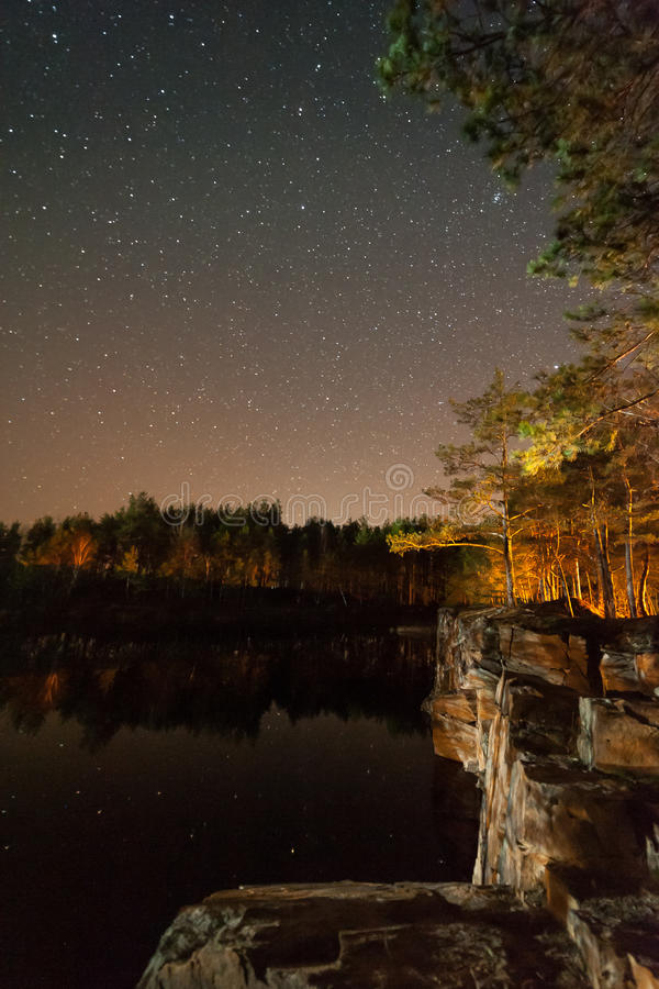 Landscape with Stars and Forest. Night landscape with stars and forest on coast of lake, high ISO stock images
