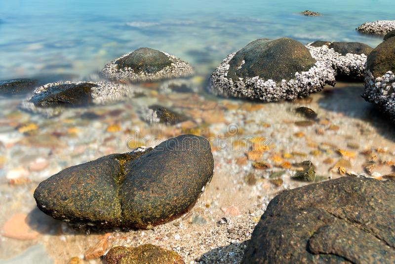 Stone in sea and wave on morning time with long exposure. Landscape stone in sea and wave on morning time with long exposure royalty free stock photo
